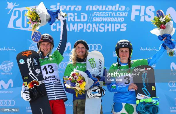Bronze medalist Chloe Trespeuch of France gold Medalist Lindsey Jacobellis of the United States and bronze medalist Michela Moioli of Italy celebrate...