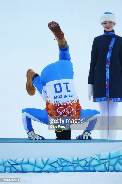 Bronze medalist Christof Innerhofer of Italy celebrates during the flower ceremony for the Alpine Skiing Men's Super Combined Downhill on day 7 of...