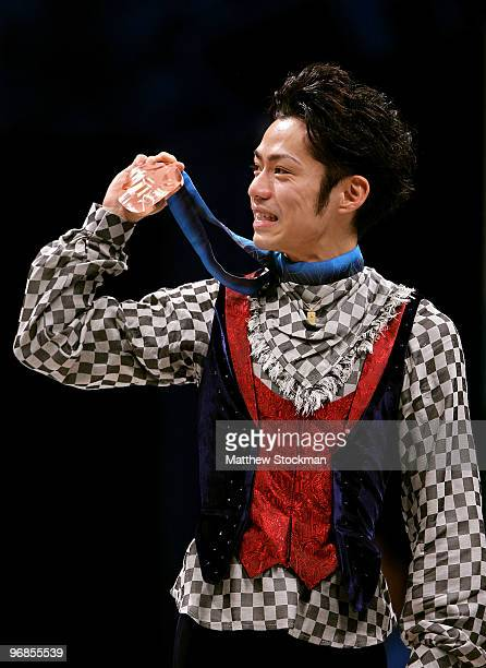 Bronze medalist Daisuke Takahashi of Japan holds his medal in the men's figure skating free skating on day 7 of the Vancouver 2010 Winter Olympics at...