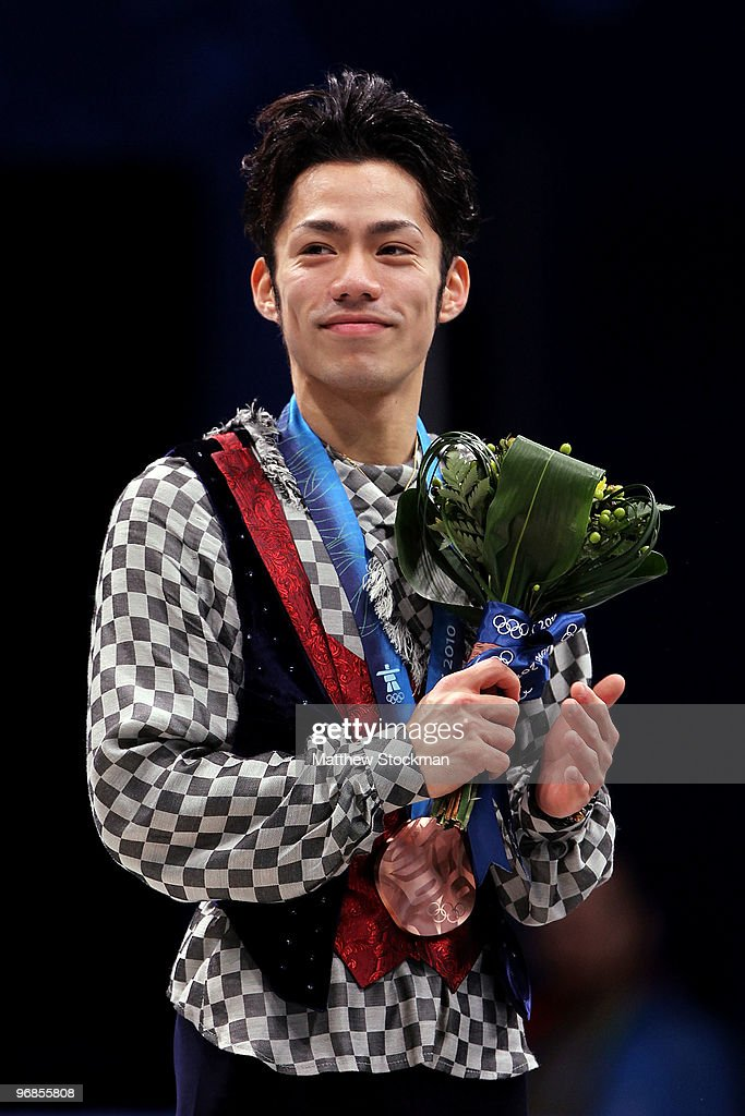 Bronze medalist <a gi-track='captionPersonalityLinkClicked' href=/galleries/search?phrase=Daisuke+Takahashi&family=editorial&specificpeople=725172 ng-click='$event.stopPropagation()'>Daisuke Takahashi</a> of Japan holds his medal in the men's figure skating free skating on day 7 of the Vancouver 2010 Winter Olympics at the Pacific Coliseum on February 18, 2010 in Vancouver, Canada.