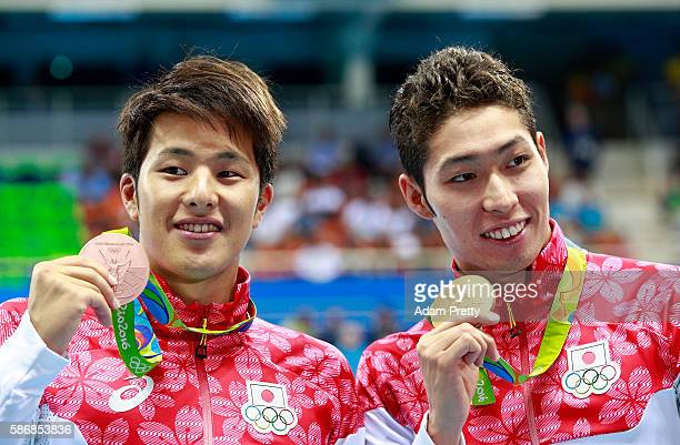 Bronze medalist Daiya Seto of Japan and gold medal medalist Kosuke Hagino of Japan and bronze medalist Daiya Seto of Japan pose during the medal...