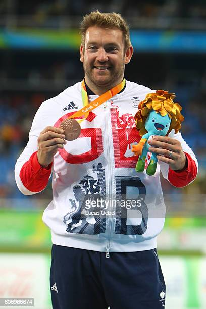 Bronze medalist Dan Greaves of Great Britain pose on the podium at the medal ceremony for Men's Discus Throw F44 during day 9 of the Rio 2016...