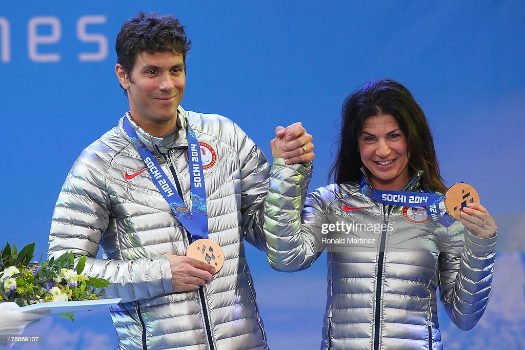 Bronze medalist Danelle Umstead and guide Robert Umsteadcelebrate at the medal ceremony for women's Super Combined Visually Impaired on day eight of the Sochi 2014 Paralympic Winter Games at Laura Cross-country Ski & Biathlon Center on March 15, 2014 in Sochi, Russia.