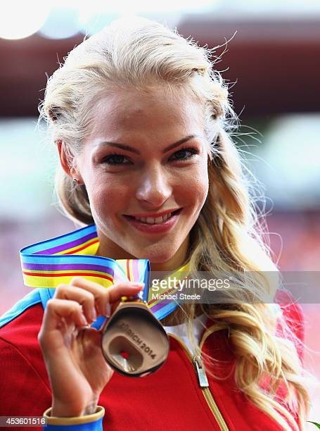 Bronze medalist Darya Klishina of Russia poses with her medal on the podium during the medal ceremony for the Women's Long Jump final during day...