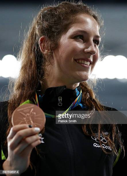Bronze medalist Eliza McCartney of New Zealand stands on the podium during the medal ceremony for the Women's Pole Vault on Day 15 of the Rio 2016...