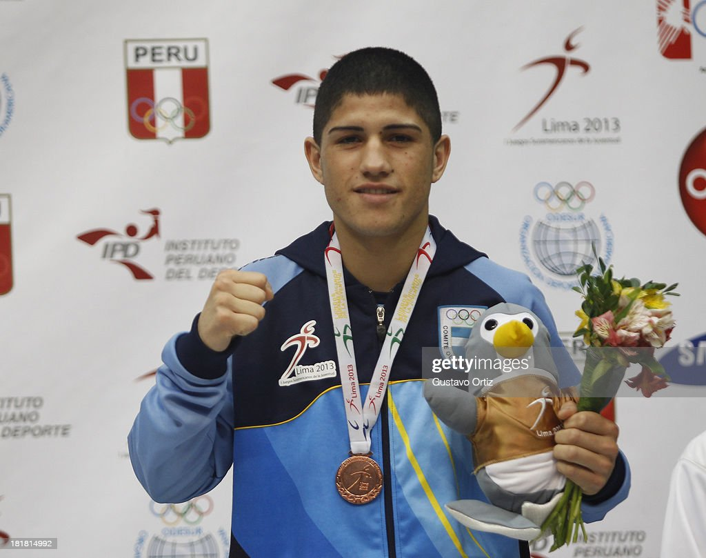 Bronze medalist Emiliano Paz of Argentina in the podium of Boxing 60kg as part of the I ODESUR South American Youth Games at Coliseo Miguel Grau on September 25, 2013 in Lima, Peru.