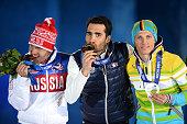 Bronze medalist Evgeniy Garanichev of Russia gold medalist Martin Fourcade of France and Silver medalist Erik Lesser of Germany celebrate on the...