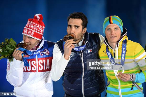 Bronze medalist Evgeniy Garanichev of Russia gold medalist Martin Fourcade of France and Silver medalist Erik Lesser of Germany celebrate on the...