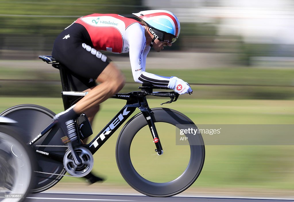 Bronze medalist Fabian Cancellara of Switzerland competes in the Elite Men's Time Trial of the UCI Road World Championships on September 25, 2013 in Florence, Italy. Tony Martin of Germany won the race ahead of Bradley Wiggins of Great Britain and Fabian Cancellara of Switzerland. AFP PHOTO / LUK BENIES