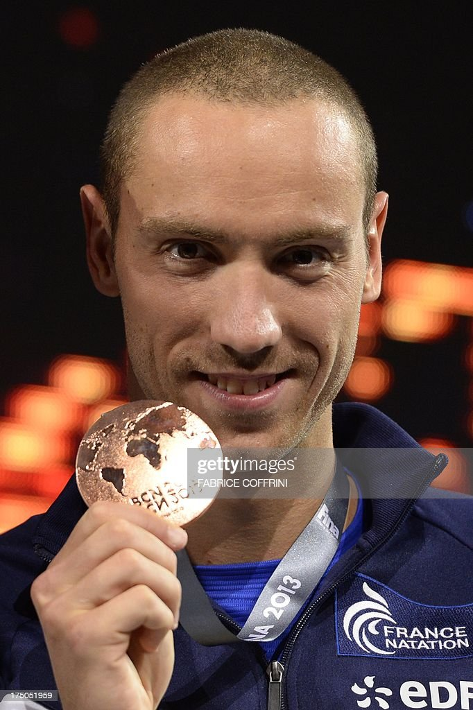 Bronze medalist France's Jeremy Stravius poses on the podium with his medal during the award ceremony of the men's 100-metre backstroke swimming event in the FINA World Championships at Palau Sant Jordi in Barcelona on July 30, 2013