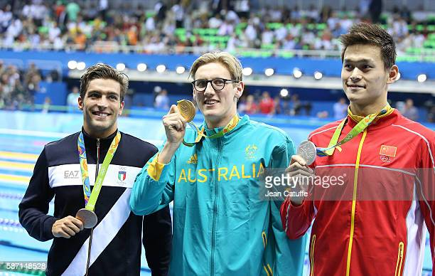 Bronze medalist Gabriele Detti of Italy gold medalist Mack Horton of Australia silver medalist Yang Sun pose during the medal ceremony for the Men's...