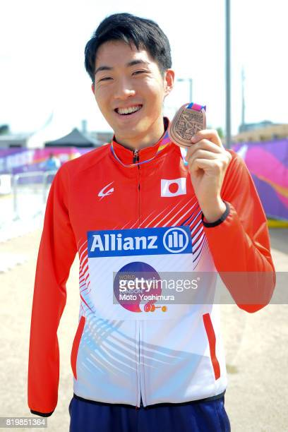 bronze medalist Hajimu Ashida of Japan pose for photographs after the medal ceremony for the Men's Triple Jump T47 during day five of the IPC World...