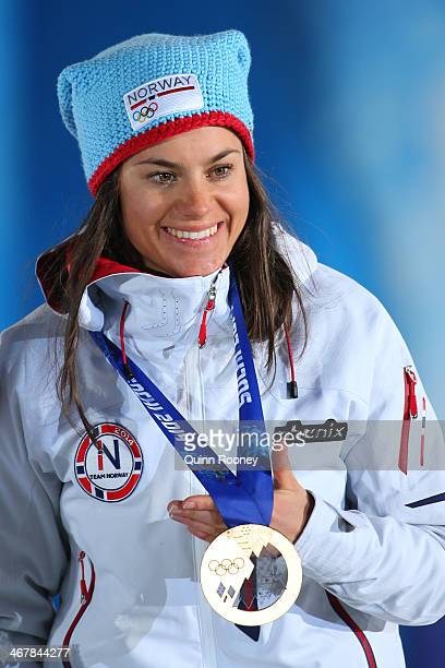 Bronze medalist Heidi Weng of Norway celebrates during the medal ceremony for the Women's Skiathlon 75km Classic 75km Free during day 1 of the Sochi...