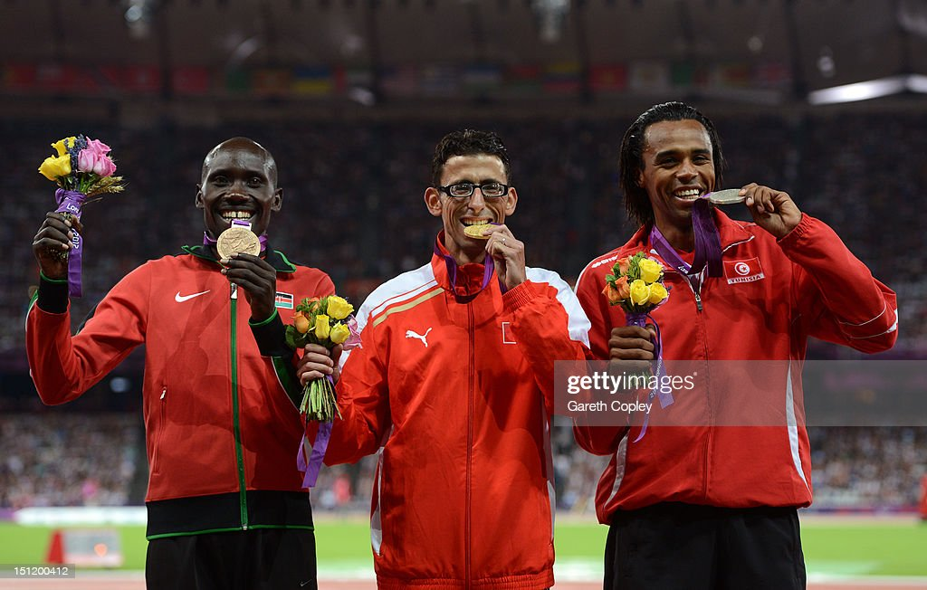 Bronze medalist Henry Kirwa of Kenya, Gold medalist El Amin Chentouf of Morocco, silver medalist Abderrahim Zhiou of Tunisia pose on the podium during the medal ceremony for the Men's 5000m - T12 on day 5 of the London 2012 Paralympic Games at Olympic Stadium on September 3, 2012 in London, England.