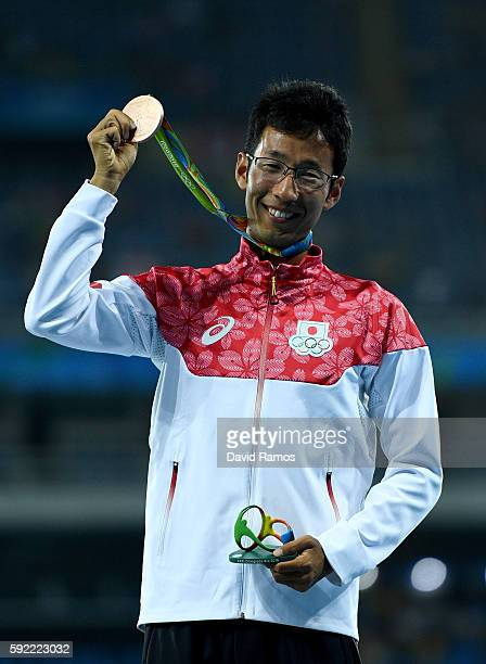 Bronze medalist Hirooki Arai of Japan poses on the podium during the medal ceremony for the Men's 50km Race Walk on Day 14 of the Rio 2016 Olympic...