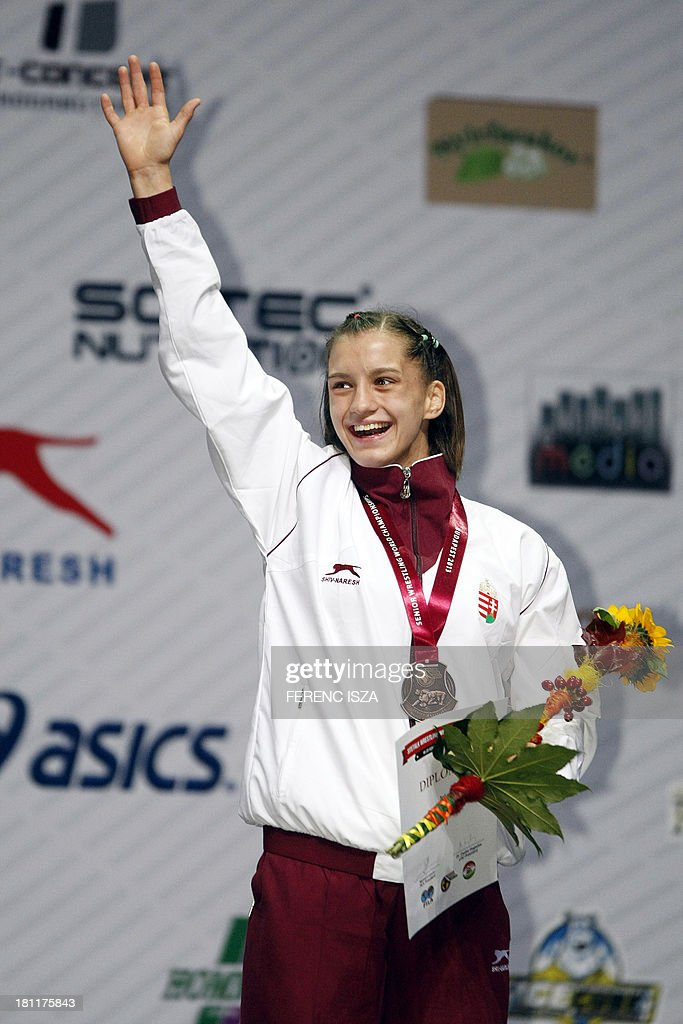 Bronze medalist Hungary's Emese Barka celebrates on the podium of the women's free style 55 kg category of the World Wrestling Championships in Budapest on September 19, 2013. AFP PHOTO / FERENC ISZA