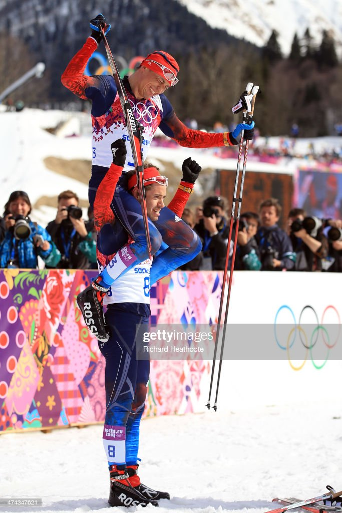 Bronze medalist Ilia Chernousov of Russia picks up gold medalist Alexander Legkov of Russia after the Men's 50 km Mass Start Free during day 16 of the Sochi 2014 Winter Olympics at Laura Cross-country Ski & Biathlon Center on February 23, 2014 in Sochi, Russia.
