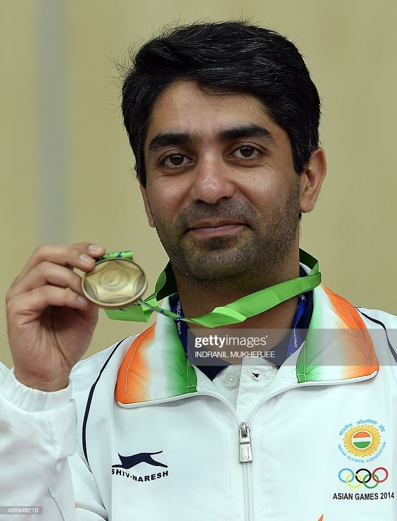 Bronze medalist India's Abhinav Bindra poses after the medal ceremony of the men's 10m air rifle individual event at the Ongnyeon International...