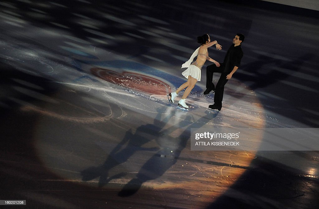 Bronze medalist Italians Anna Cappellini and Luca Lanotte perform on ice at the 'Dom Sportova' sports hall in Zagreb on January 27, 2013 during the gala of the ISU European Figure Skating Championships.