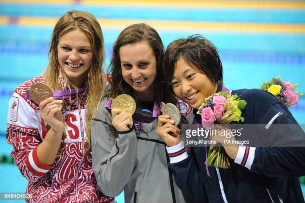 Bronze Medalist Iulia Efimova Gold Medalist Rebecca Soni and Silver Medalist Satomi Suzuki with their medals after the Women's 200m Breaststroke...