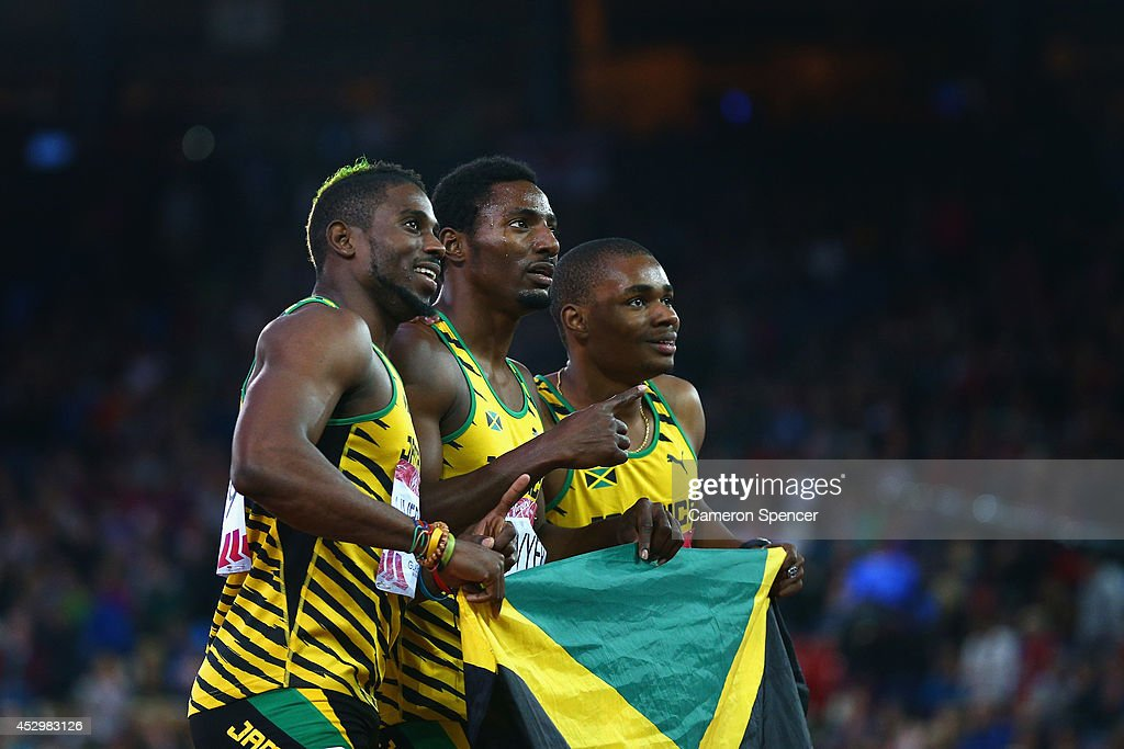 Bronze medalist <a gi-track='captionPersonalityLinkClicked' href=/galleries/search?phrase=Jason+Livermore&family=editorial&specificpeople=7165850 ng-click='$event.stopPropagation()'>Jason Livermore</a> of Jamaica, gold medalist <a gi-track='captionPersonalityLinkClicked' href=/galleries/search?phrase=Rasheed+Dwyer&family=editorial&specificpeople=7243414 ng-click='$event.stopPropagation()'>Rasheed Dwyer</a> of Jamaica silver medalist <a gi-track='captionPersonalityLinkClicked' href=/galleries/search?phrase=Warren+Weir&family=editorial&specificpeople=9482526 ng-click='$event.stopPropagation()'>Warren Weir</a> of Jamaica celebrate after the Men's 200 metres Final at Hampden Park during day eight of the Glasgow 2014 Commonwealth Games on July 31, 2014 in Glasgow, United Kingdom.