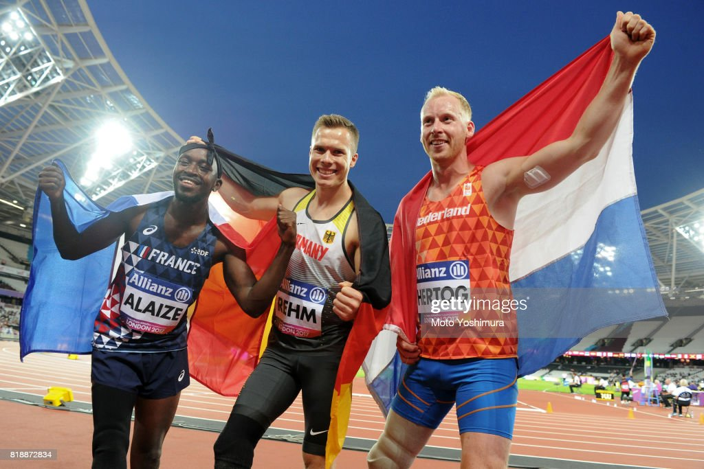 Bronze medalist Jean-Baptiste Alaize of France, gold medalist Markus Rehm of Germany and silver medalist Ronald Hertog of the Netherlands pose for photographs after the medal ceremony for the Men's Long Jump T44 during the IPC World ParaAthletics Championships 2017 at London Stadium on July 17, 2017 in London, England.