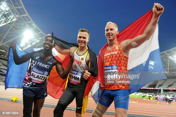 Bronze medalist JeanBaptiste Alaize of France gold medalist Markus Rehm of Germany and silver medalist Ronald Hertog of the Netherlands pose for...