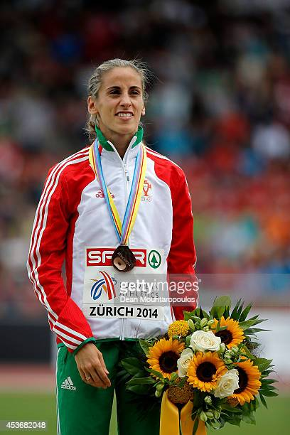 Bronze medalist Jessica Augusto of Portugal poses with her medal on the podium during the medal ceremony for the Women's Marathon during day five of...