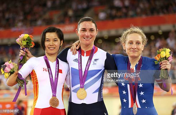 Bronze medalist Jianping Ruan Gold medalist Sarah Storey of Great Britain and Silver medalist Jennifer Schube of the United States pose on the podium...
