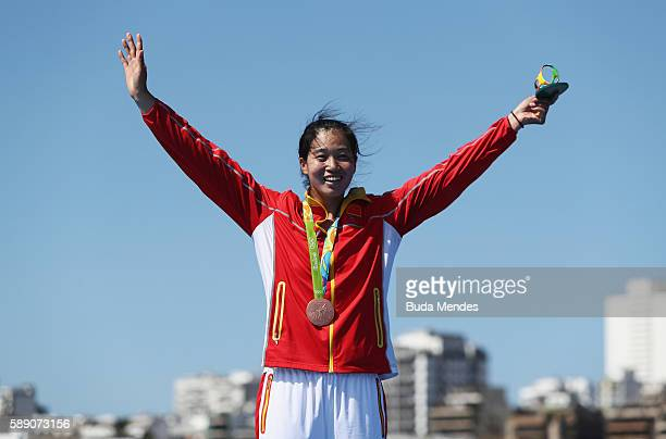Bronze medalist Jingli Duan of China celebrates on the podium at the medal ceremony for the Women's Single Sculls on Day 8 of the Rio 2016 Olympic...