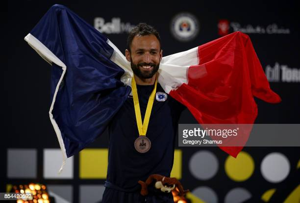 Bronze medalist Jonathan Hamou of France poses on the podium at the medal ceremony for the Indoor Rowing Men's IR3 Four Minute Endurance Final during...