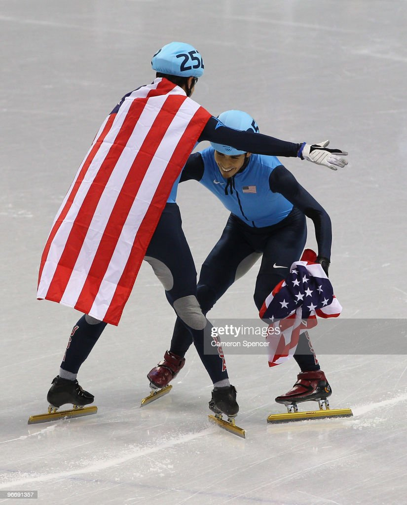 Bronze medalist J.R. Celski of the United States is picked up by silver medalist Apolo Anton Ohno of United States after the 1500 m men's short track on day 2 of the Vancouver 2010 Winter Olympics at Pacific Coliseum on February 13, 2010 in Vancouver, Canada.