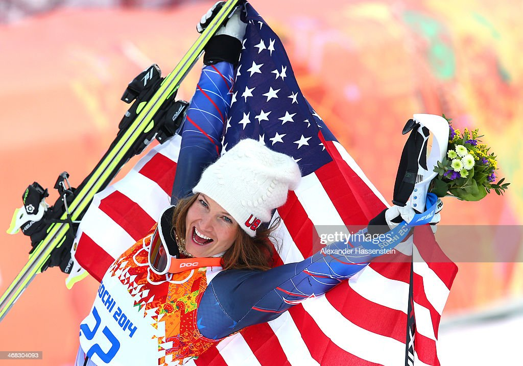Bronze medalist <a gi-track='captionPersonalityLinkClicked' href=/galleries/search?phrase=Julia+Mancuso&family=editorial&specificpeople=214615 ng-click='$event.stopPropagation()'>Julia Mancuso</a> of the United States celebrates during the flower ceremony for the Alpine Skiing Women's Super Combined on day 3 of the Sochi 2014 Winter Olympics at Rosa Khutor Alpine Center on February 10, 2014 in Sochi, Russia.