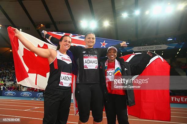Bronze medalist Julie Labonte of Canada Gold medalist Valerie Adams of New Zealand and silver medalist Cleopatra Borel of Trinidad and Tobago...