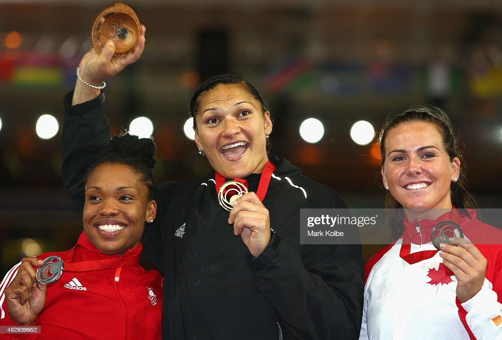Bronze medalist Julie Labonte of Canada, Gold medalist <a gi-track='captionPersonalityLinkClicked' href=/galleries/search?phrase=Valerie+Adams&family=editorial&specificpeople=2174723 ng-click='$event.stopPropagation()'>Valerie Adams</a> of New Zealand and silver medalist Cleopatra Borel of Trinidad and Tobago pose on the podium during the medal ceremony for the Women's Shot Put at Hampden Park during day seven of the Glasgow 2014 Commonwealth Games on July 30, 2014 in Glasgow, United Kingdom.