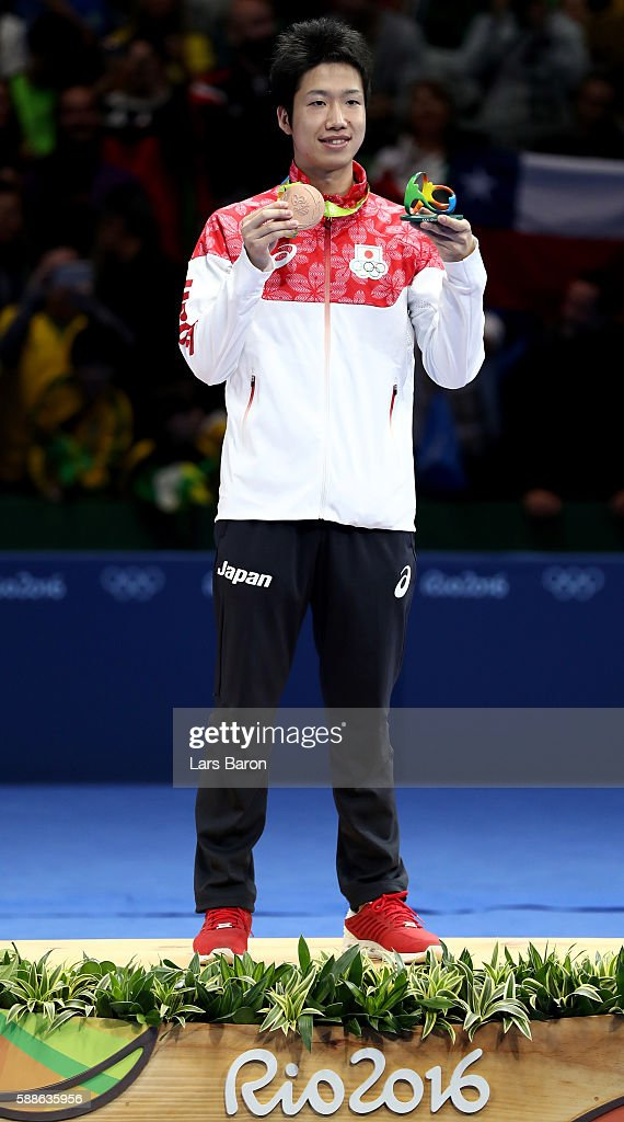Bronze medalist Jun Mizutani of Japan poses on the podium during the medal ceremony for the Mens Table Tennis Gold Medal match between Ma Long of China and Zhang Jike of China at Rio Centro on August 11, 2016 in Rio de Janeiro, Brazil.