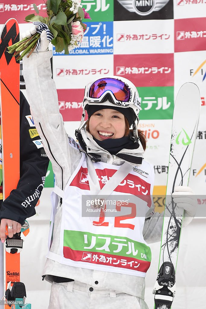 Bronze medalist Junko Hoshino of Japan poses on the podium in the medal ceremony for dual moguls during 2014 FIS Free Style Ski World Cup Inawashiro...