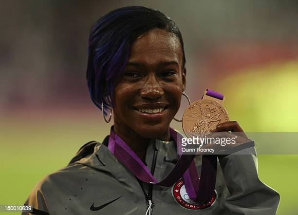 Bronze medalist Kellie Wells of the United States poses on the podium during the medal ceremony for the Women's 100m Hurdles on Day 12 of the London...
