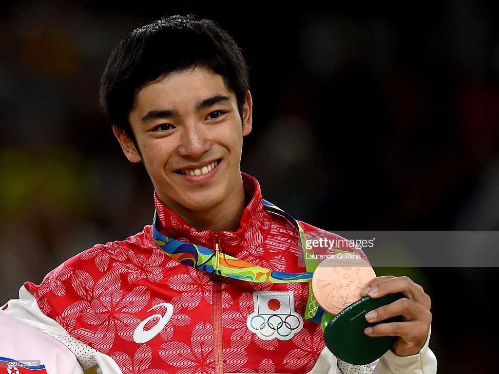 Bronze medalist Kenzo Shirai of Japan poses for photographs on the podium at the medal ceremony for Men's Vault on day 10 of the Rio 2016 Olympic...