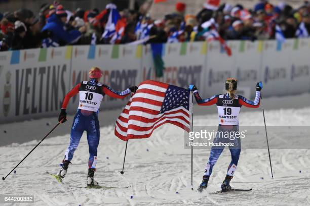 Bronze medalist Kikkan Randall of the United States and silver medalist Jessica Diggins of the United States celebrate following the Women's 14KM...