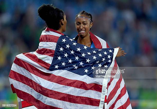 Bronze medalist Kristi Castlin and gold medalist Brianna Rollins of the United States celebrate after the Women's 100m Hurdles Final on Day 12 of the...