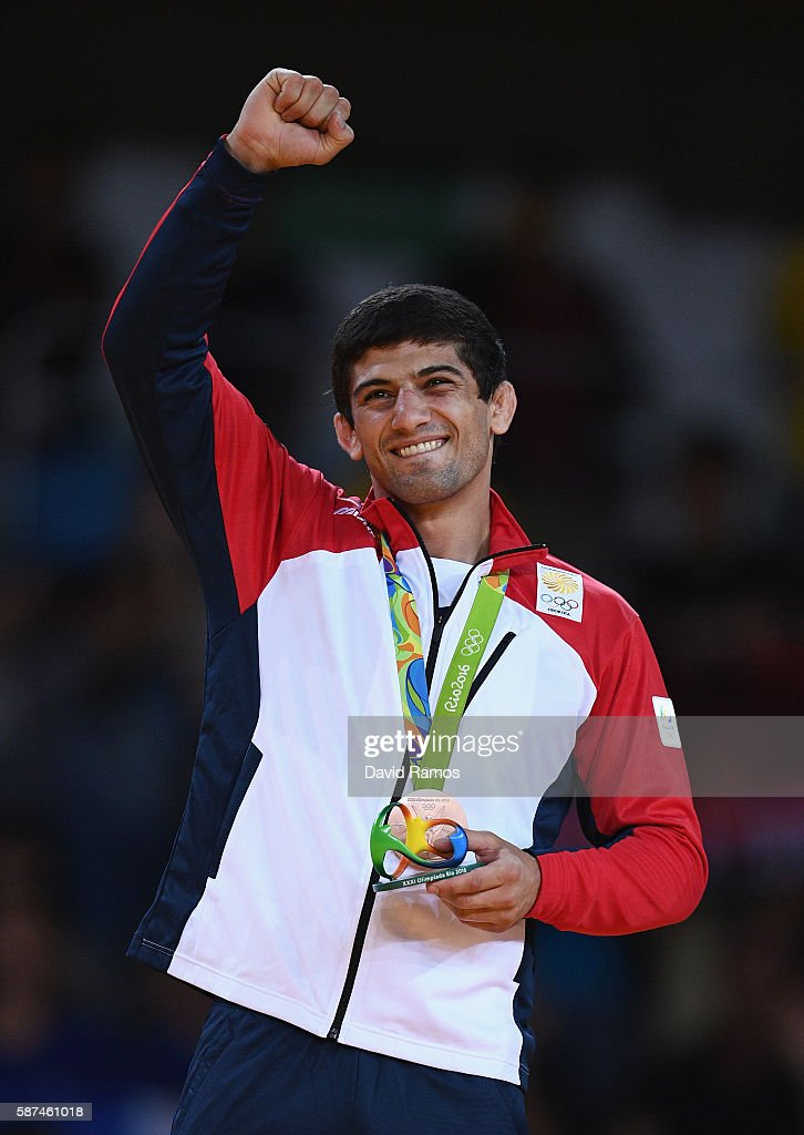Bronze medalist Lasha Shavdatuashvili of Georgia celebrates on the podium after the Men's 73 kg Judo contest on Day 3 of the Rio 2016 Olympic Games...
