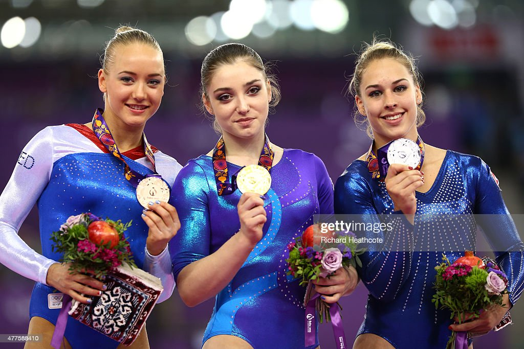 Bronze medalist Lieke Wevers of Netherlands, gold medalist <a gi-track='captionPersonalityLinkClicked' href=/galleries/search?phrase=Aliya+Mustafina&family=editorial&specificpeople=5094716 ng-click='$event.stopPropagation()'>Aliya Mustafina</a> of Russia and Silver medalist <a gi-track='captionPersonalityLinkClicked' href=/galleries/search?phrase=Giulia+Steingruber&family=editorial&specificpeople=8524243 ng-click='$event.stopPropagation()'>Giulia Steingruber</a> of Switzerland pose with the medals won in the Women's Individual All-Around final on day six of the Baku 2015 European Games at National Gymnastics Arena on June 18, 2015 in Baku, Azerbaijan.