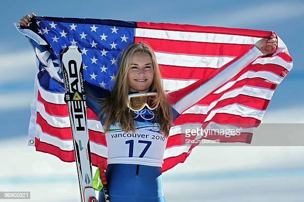 Bronze medalist Lindsey Vonn of the United States celebrates with the American flag after the women's alpine skiing SuperG on day nine of the...