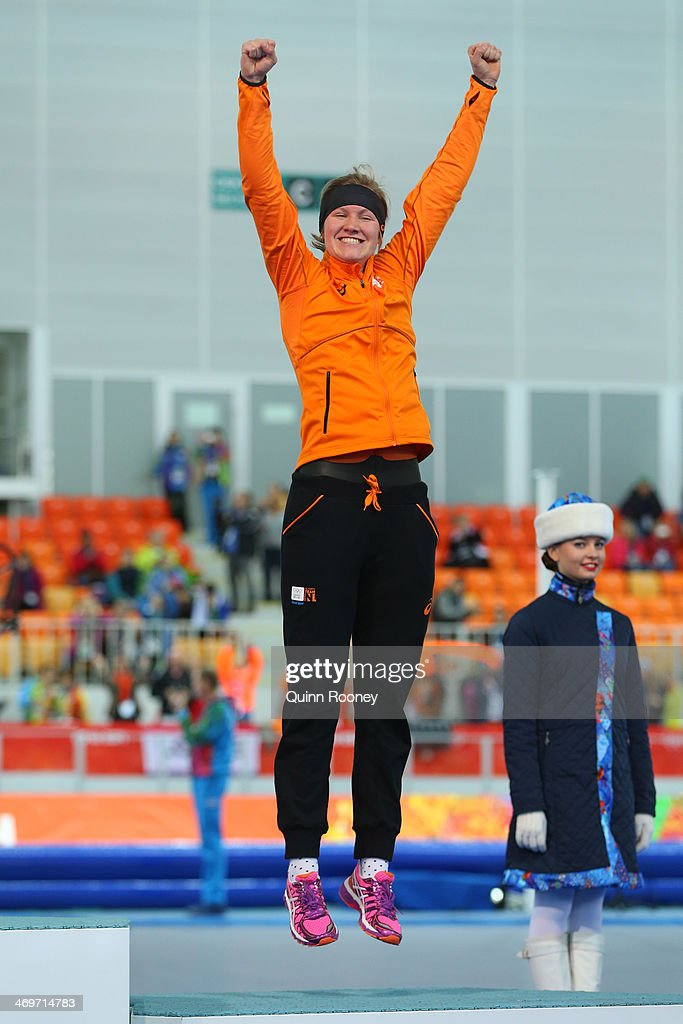 Bronze medalist <a gi-track='captionPersonalityLinkClicked' href=/galleries/search?phrase=Lotte+van+Beek&family=editorial&specificpeople=9989212 ng-click='$event.stopPropagation()'>Lotte van Beek</a> of the Netherlands celebrates during the flower ceremony for the Speed Skating Women's 1500m on day 9 of the Sochi 2014 Winter Olympics at Adler Arena Skating Center on February 16, 2014 in Sochi, Russia.