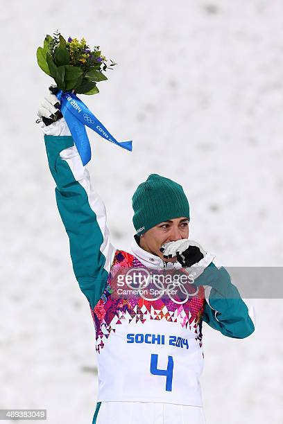 Bronze medalist Lydia Lassila of Australia celebrates during the flower ceremony for the Freestyle Skiing Ladies' Aerials Finals on day seven of the...