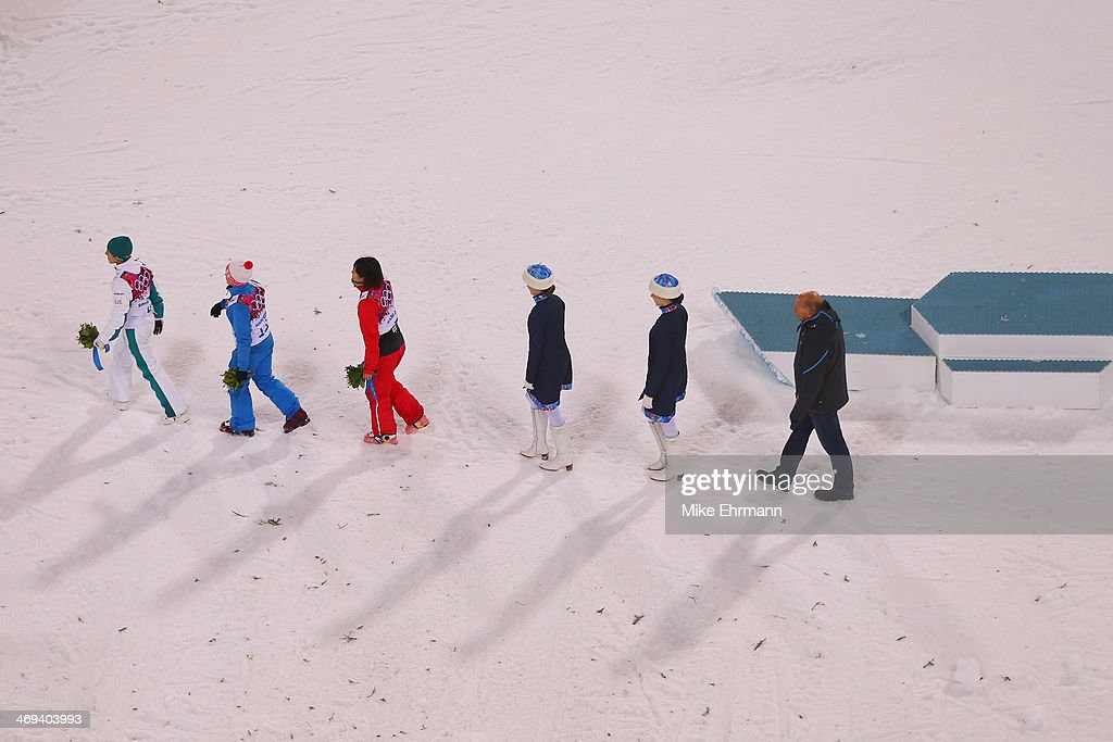 Bronze medalist Lydia Lassila of Australia, gold medalist Alla Tsuper of Belarus and silver medalist Xu Mengtao of China pose during the flower ceremony for the Freestyle Skiing Ladies' Aerials Finals on day seven of the Sochi 2014 Winter Olympics at Rosa Khutor Extreme Park on February 14, 2014 in Sochi, Russia.