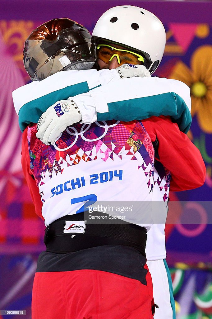 Bronze medalist Lydia Lassila of Australia hugs silver medalist Xu Mengtao of China in the Freestyle Skiing Ladies' Aerials Finals on day seven of the Sochi 2014 Winter Olympics at Rosa Khutor Extreme Park on February 14, 2014 in Sochi, Russia.