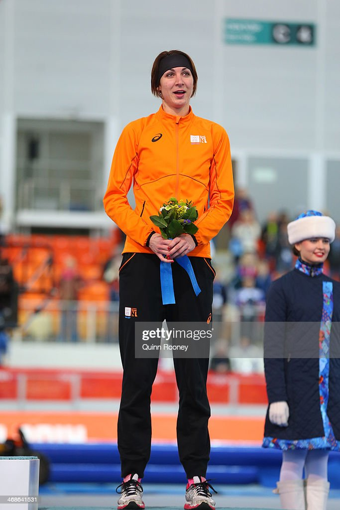 Bronze medalist <a gi-track='captionPersonalityLinkClicked' href=/galleries/search?phrase=Margot+Boer&family=editorial&specificpeople=4691692 ng-click='$event.stopPropagation()'>Margot Boer</a> of the Netherlands celebrates on the podium during the flower ceremony for the Speed Skating Women's 500m Event during day 4 of the Sochi 2014 Winter Olympics at Adler Arena Skating Center on February 11, 2014 in Sochi, Russia.