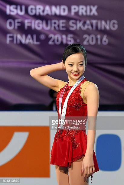 Bronze medalist Marin Honda of Japan celebrates on the podium at the medal ceremony for the Junior Ladies Singles during day three of the ISU Grand...